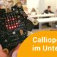 Calliope Mini, im Hintergrund programmieren Schüler