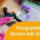 Schülerin programmiert mit Scratch ein Spiel
